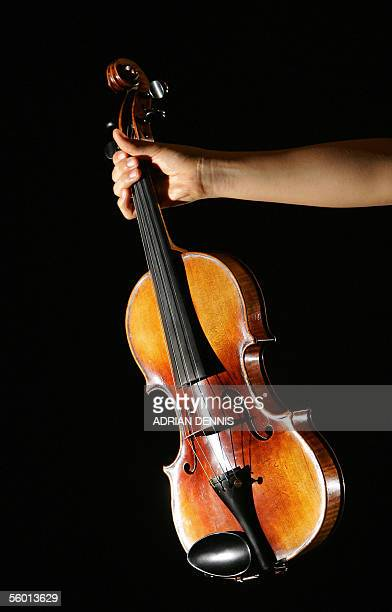 Fifteenyearold music student Mari Lee holds a violin previously owned by Nicolo Paganini one of the world's greatest virtuoso violinists of all time...