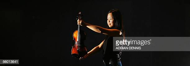 Fifteenyearold music student Mari Lee holds a violin previously owned by Nicolo Paganini one of the world's greatest virtuoso violinist's of all time...