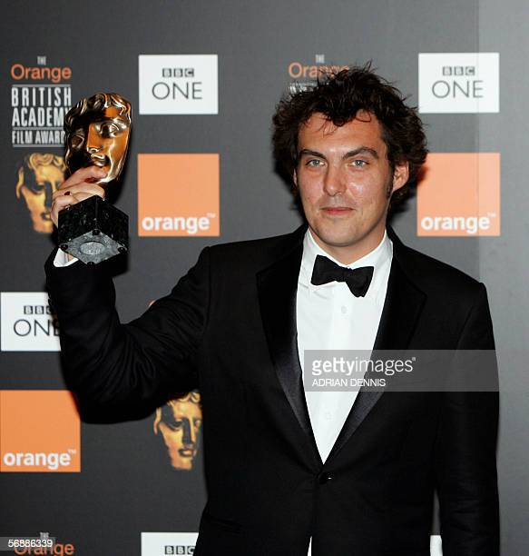 Film director Joe Wright poses for photographs after winning the Carl Foreman award for 'Pride and Prejudice' at the British Academy of Film and...
