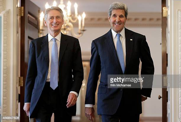 United Kingdom Foreign Minister Philip Hammond and US Secretary of State John Kerry arrive for a joint press conference following a private meeting...
