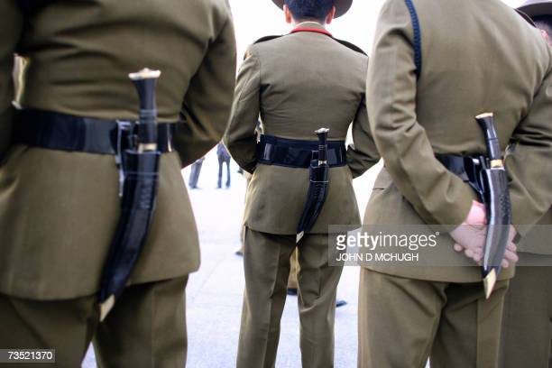 Gurkhas soldiers wearing their traditional Kukri knives stand and chat with each other at Wellington Barracks in London 08 March 2007 following a...