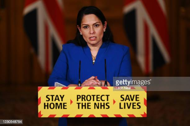 United Kingdom Home Secretary Priti Patel talks at a coronavirus press conference at Downing Street on January 12, 2021 in London, England. The Home...