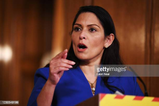 United Kingdom Home Secretary Priti Patel talks at a coronavirus press conference at Downing Street on January 12, 2021 in London, England. The Home...