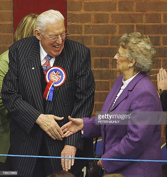 United Kingdom: Ian Paisley , leader of the Democratic Unionist Party , shakes hands with his wife Eileen Paisley after winning the election in...