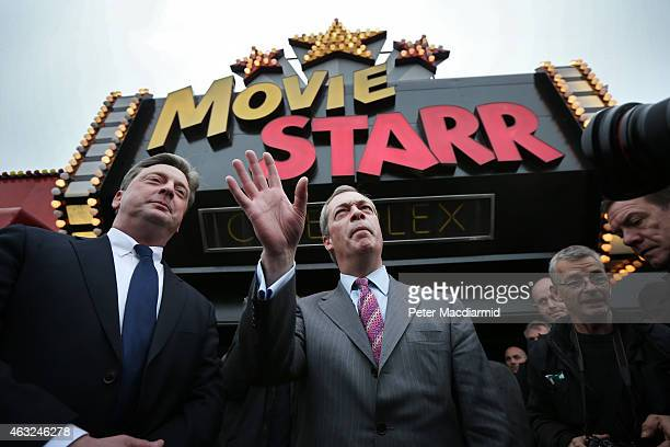 United Kingdom Indepedence Party leader Nigel Farage gestures as he arrives at the Movie Starr cinema to make a campaign speech on February 12 2015...