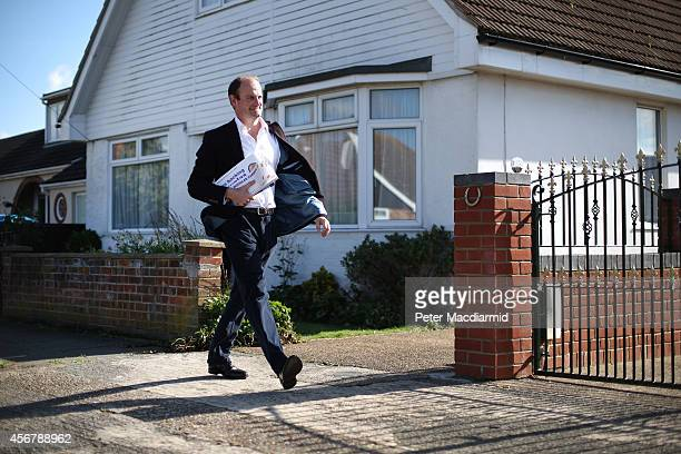 United Kingdom Independence Party candidate Douglas Carswell canvasses for votes in a residential area on October 7 2014 in ClactononSea England A...