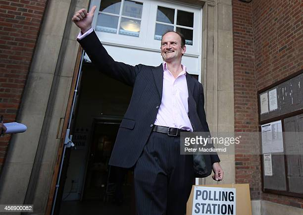 United Kingdom Independence Party candidate Douglas Carswell gestures as he leaves a polling station on October 9 2014 in ClactononSea England Polls...