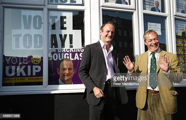 United Kingdom Independence Party candidate Douglas Carswell stands with party leader Nigel Farage on October 9 2014 in ClactononSea England Polls...