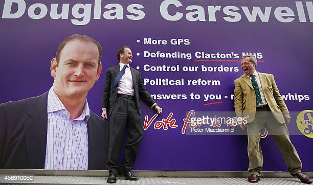 United Kingdom Independence Party candidate Douglas Carswell stands with party leader Nigel Farage on a mobile poster truck on polling day on October...