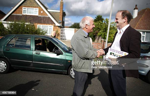 United Kingdom Independence Party candidate Douglas Carswell talks to a voter on October 7 2014 in ClactononSea England A byelection is being held in...