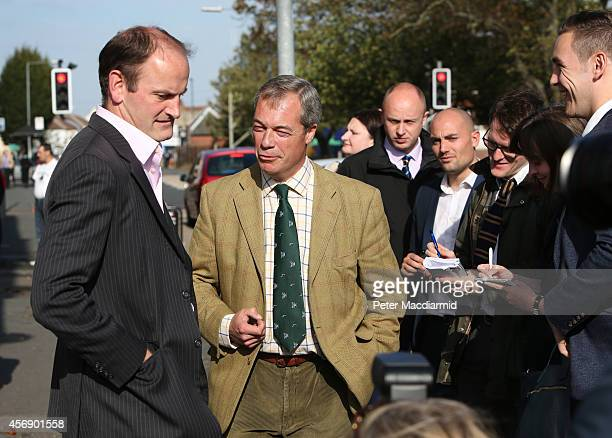 United Kingdom Independence Party candidate Douglas Carswell talks to party leader Nigel Farage on October 9 2014 in ClactononSea England Polls have...