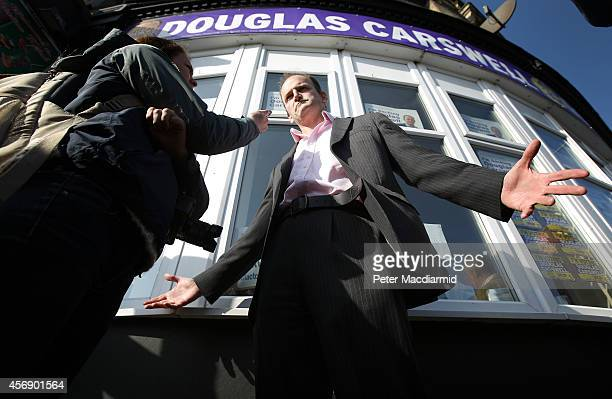 United Kingdom Independence Party candidate Douglas Carswell talks to a reporter outside party headquarters on October 9 2014 in ClactononSea England...