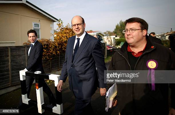 United Kingdom Independence Party candidate Mark Reckless walks with campaign workers on November 19, 2014 in Hoo near Rochester, England. A...
