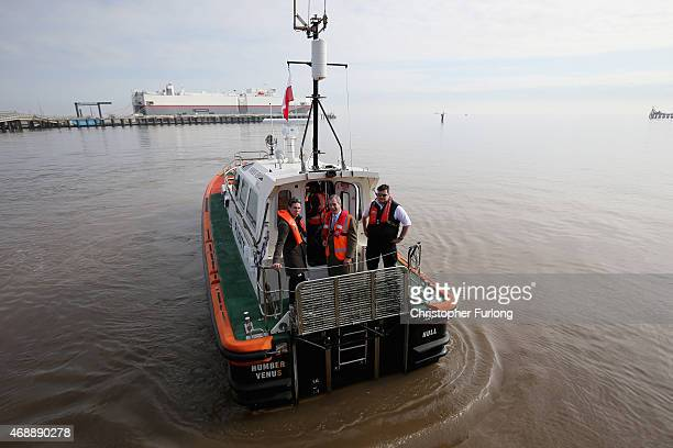 United Kingdom Independence Party leader Nigel Farage and reality tv star Joey Essex on board the Grimsby pilot boat during campaigning on April 8...