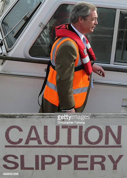 United Kingdom Independence Party leader Nigel Farage boards the Grimsby pilot boat during campaigning on April 8, 2015 in Grimsby, United Kingdom....