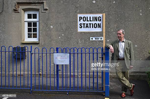 United Kingdom Independence Party leader Nigel Farage poses for photographs near Biggin Hill, south of London, after voting in the local and European...