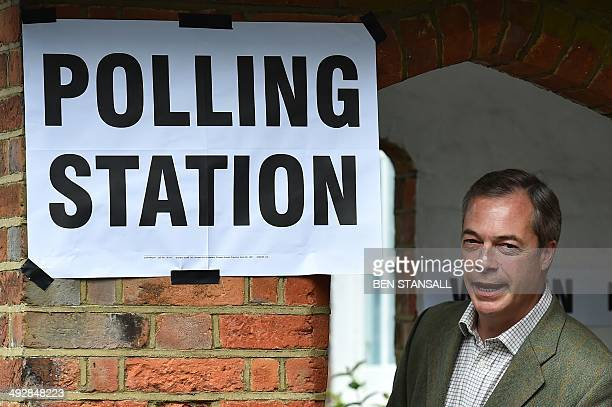 United Kingdom Independence Party leader Nigel Farage poses for photographs near Biggin Hill, south of London, before voting in the local and...