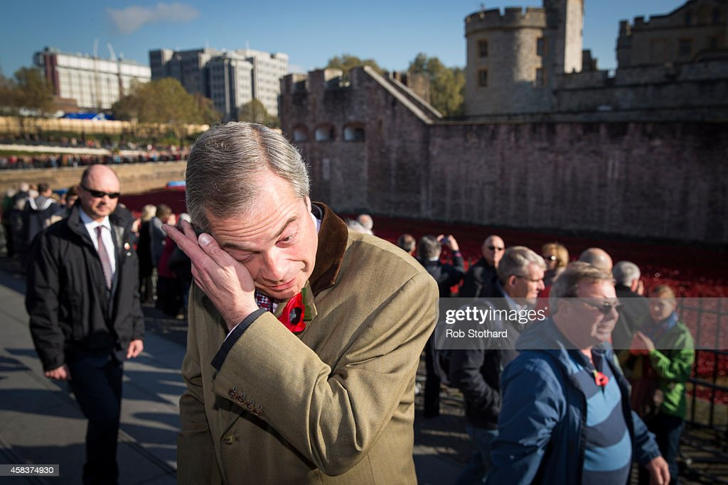 UKIP Leader Nigel Farage Visits The Poppy Installation At The Tower Of London : News Photo