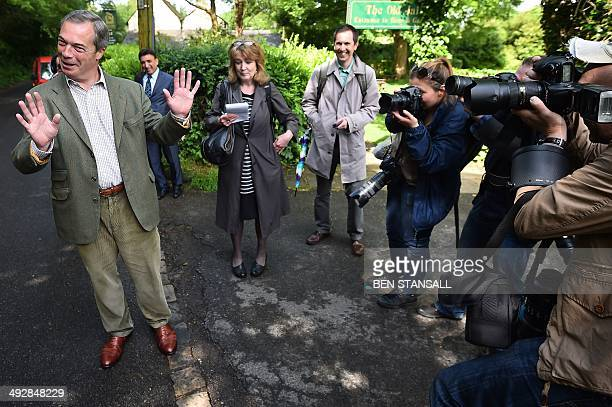 United Kingdom Independence Party leader Nigel Farage with members of the media near Biggin Hill, south of London, after voting in the local and...