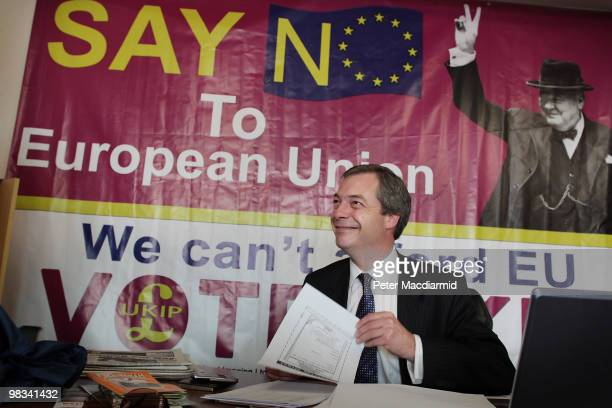 United Kingdom Independence Party member Nigel Farage sits at his desk at campaign headquarters on April 8, 2010 in Buckingham, England. UKIP Member...