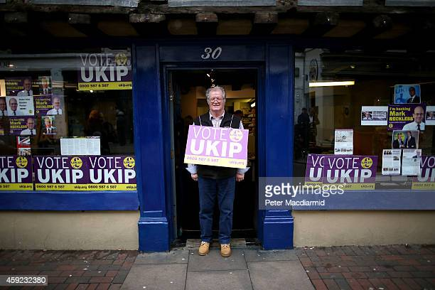 United Kingdom Independence Party supporter stands in the doorway of their headquarters on November 19, 2014 in Rochester, England. A parliamentary...