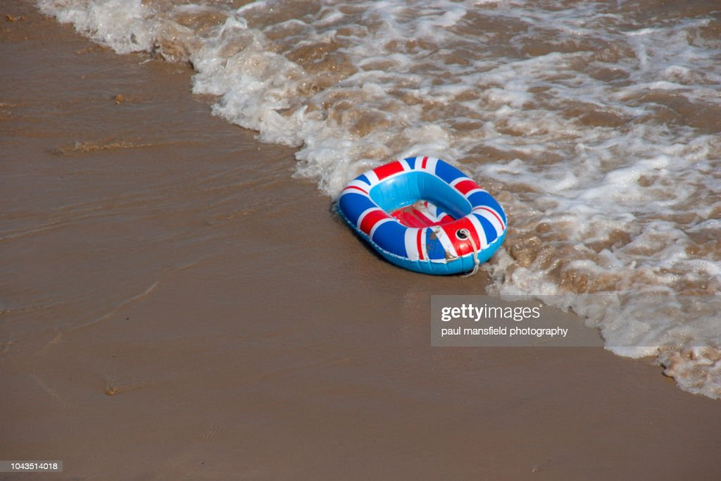 A united kingdom inflatable boat at waters edge : Stock Photo