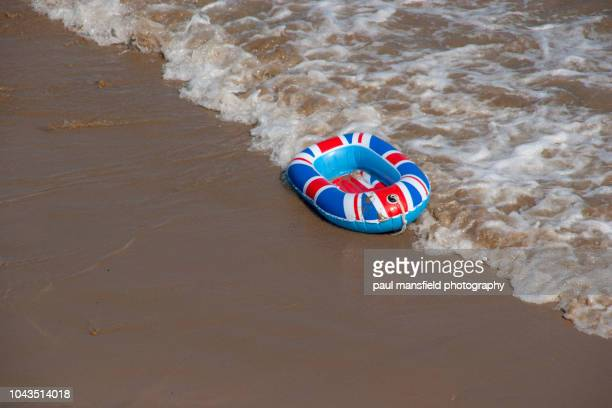 a united kingdom inflatable boat at waters edge - brexit stock pictures, royalty-free photos & images
