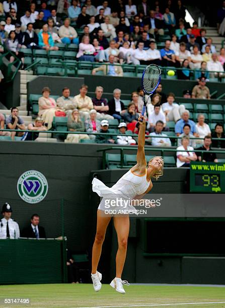 Maria Sharapova of Russia serves to Katerina Srebotnik of Slovakia during their match at the 119th Wimbledon Tennis Championships in London 24 June...