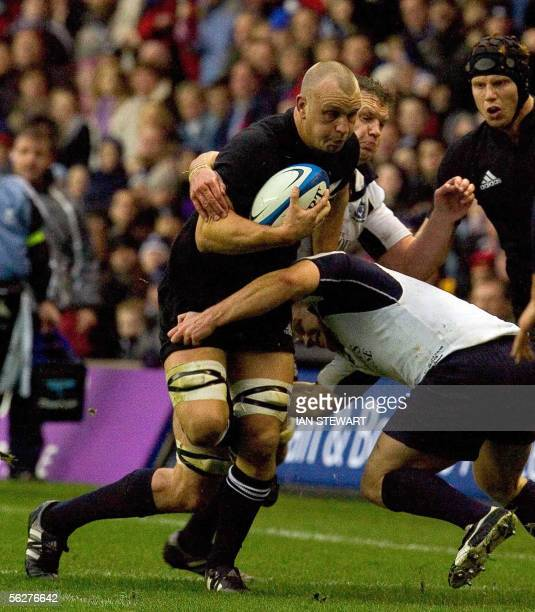 New Zealand All Black Angus McDonald powers through the Scottish defence during a rugby union international match at Murrayfield in Edinburgh...