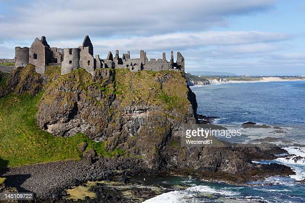 united kingdom, northern ireland, county antrim, view of dunluce castle - dunluce castle stock photos and pictures