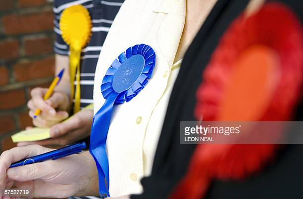 United Kingdom: Officials from the Liberal Democrat, Conservative and Labour party monitor voter turn-out outside a polling station in Wandsworth, in...