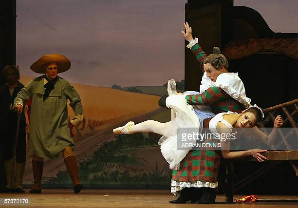United Kingdom: Philip Mosley playing Widow Simone performs alongside Roberta Marquez playing Lise and William Tuckett as Thomas during a dress...