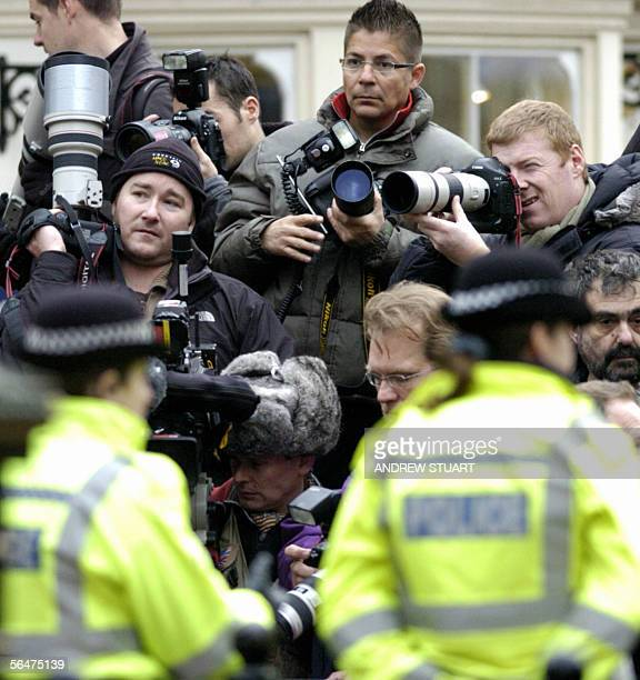 Photographers gather beside the entrance to the registry office at the Guildhall in Windsor 21 December 2005 which will host a civil wedding ceremony...
