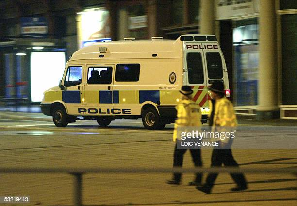 police officers stand guard to close the center of Birmingham because of a bomb alert during the night of the 10 July 2005 in Birmingham Some 20000...