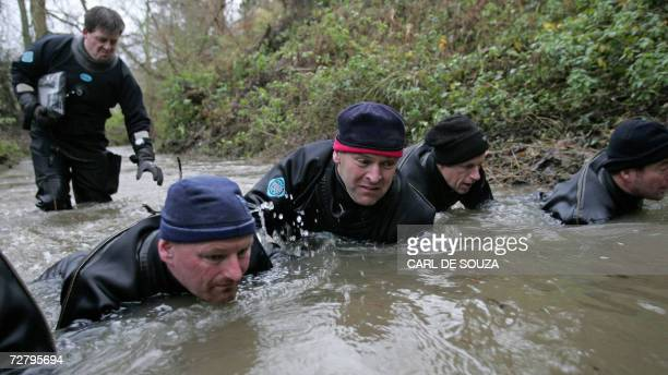 Police Underwater Search and Recovery Divers search a stream 11 December 2006 in Copdock near Ipswich in Suffolk where the body of prostitute Tania...