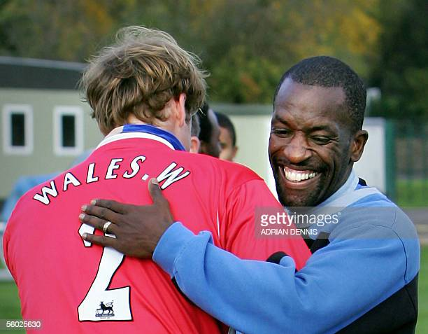 Prince William embraces Chris Powell of Charlton Athletic football team during a visit to the clubs' training ground in Eltham south London 28...