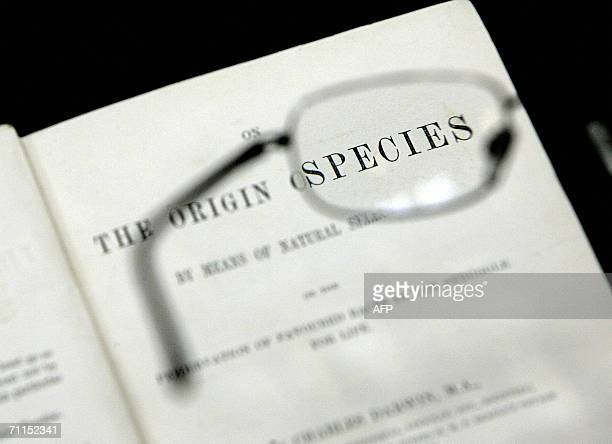 United Kingdom: Reading glasses are held over the first printed edition of the book 'Origin of Species' by Charles Darwin at London's Natural History...
