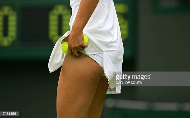 Russia's Maria Sharapova places tennis balls into her shorts as she plays against Israel's Anna Smashnova on the third day of the Wimbledon...