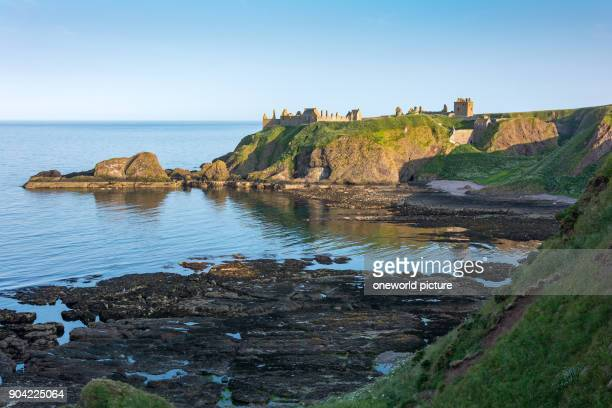 United Kingdom, Scotland, Aberdeenshire, Stonehaven, Dunnottar Castle from a distance, Dunnottar Castle, is a castle ruin, hiding the Scottish crown...