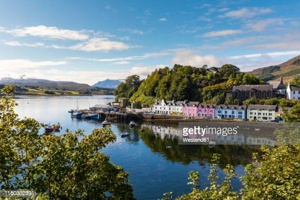 united kingdom, scotland, colorful houses in portree, isle of skye - harbour stock pictures, royalty-free photos & images