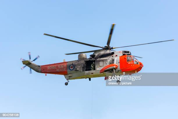United Kingdom Scotland East Lothian North Berwick Royal Navy Sea King at the annual Scotlands National Airshow in East Fortune abseiling from the...