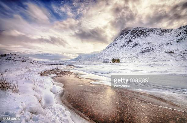 United Kingdom, Scotland, Glencoe, Solitude, house at river in winter