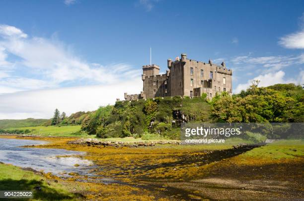 United Kingdom Scotland Highland Isle of Skye Dunvegan Castle from a distance Dunvegan Castle is the tribal seat of the Scottish clan of the MacLeods...