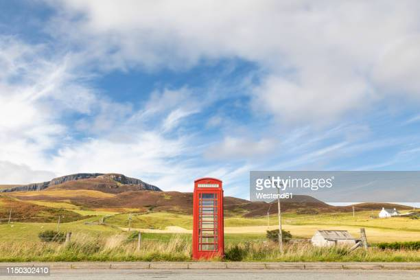 united kingdom, scotland, red phone booth in the countryside on the isle of skye - rural scene stock pictures, royalty-free photos & images