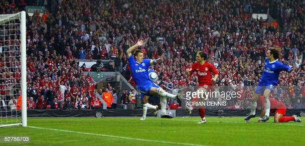 Sequence 2 of 7 Liverpool's Luis Garcia watches his shot at goal hit Chelsea's John Terry as Milan Baros looks on during the Champions League...