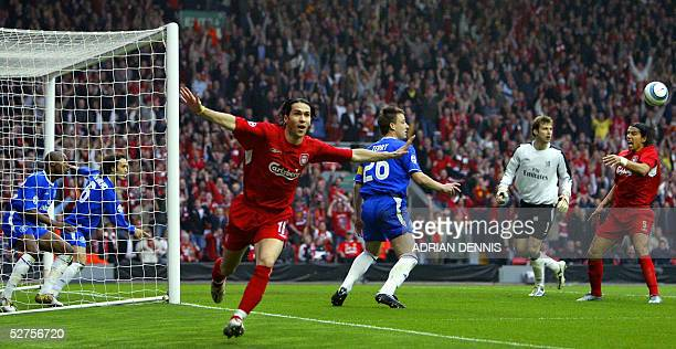 United Kingdom: Sequence 7 of 7 - Liverpool's Luis Garcia celebrates scoring a goal as Chelsea's William Gallas tried to clear the ball alongside...