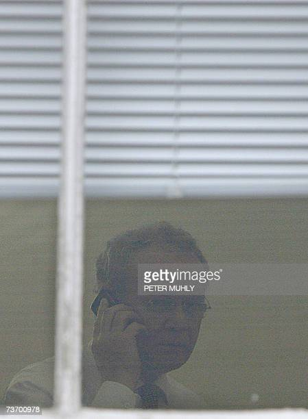 United Kingdom: Sinn Fein's chief negociator Martin McGuniess receives a phone call as he is seen though a window at Stormont in Belfast, Northern...
