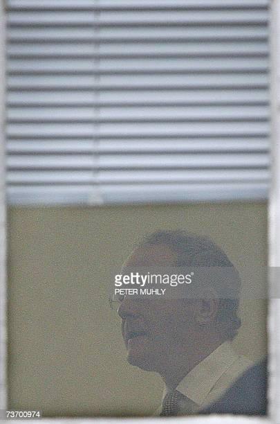 United Kingdom: Sinn Fein's chief negociator Martin McGuniess talks with colleague as he is seen though a window at Stormont in Belfast, Northern...