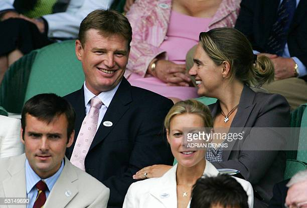South African golfer Ernie Els sits with his wife Liezl in the Royal Box on Centre Court at the 119th Wimbledon Tennis Championships in London 25...
