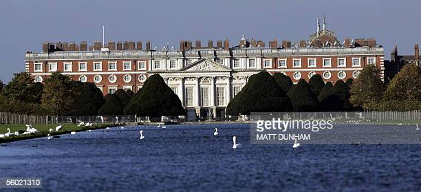 Swans sit in a lake on the grounds of Hampton Court Palace in London 27 October 2005 EU Heads of State gathered Thursday for an Informal Summit of EU...